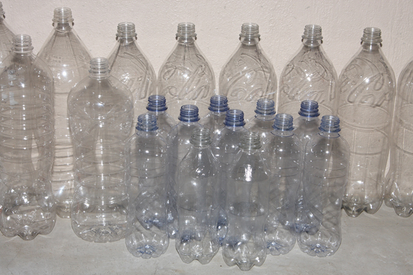 Plastic bottles with labels and caps removed.